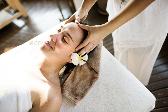 Woman relaxing from a spa treatment - Stock Photo - Images