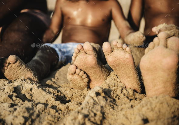 African family enjoying the beach - Stock Photo - Images