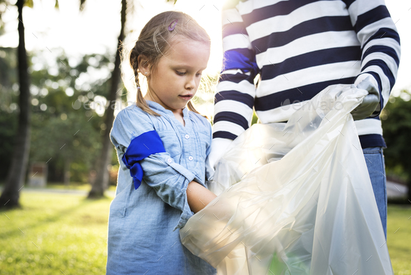 Kids picking up trash in the park - Stock Photo - Images