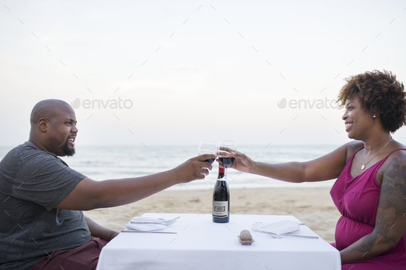 Couple having a romantic dinner at the beach - Stock Photo - Images