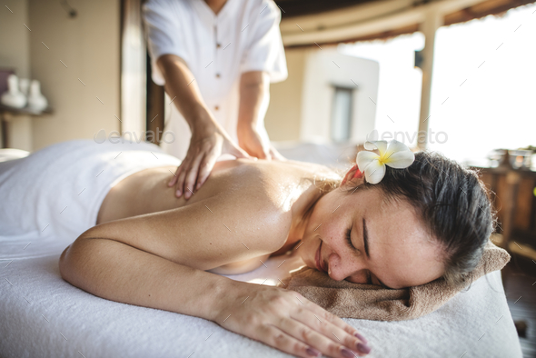 Woman relaxing with a herbal massage - Stock Photo - Images