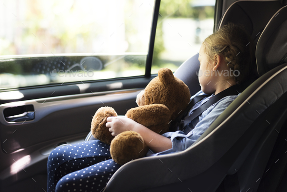 A little girl in a car seat - Stock Photo - Images