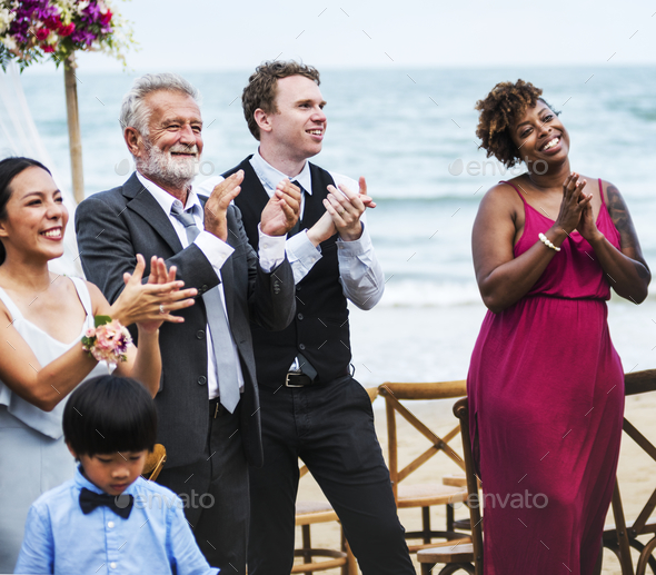 Wedding guests clapping for the bride and groom - Stock Photo - Images