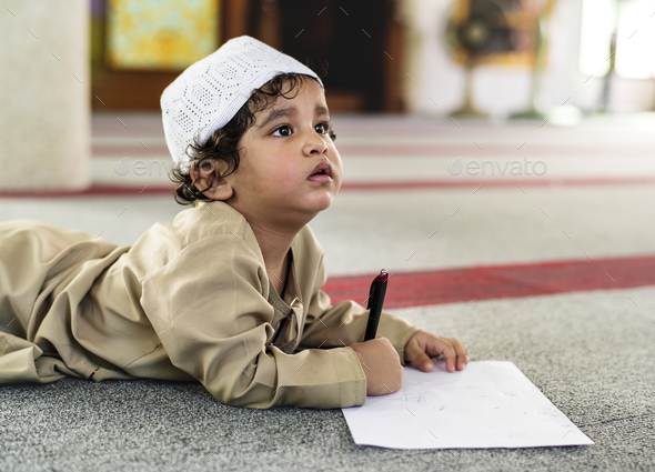 Muslim boy learning in a mosque - Stock Photo - Images