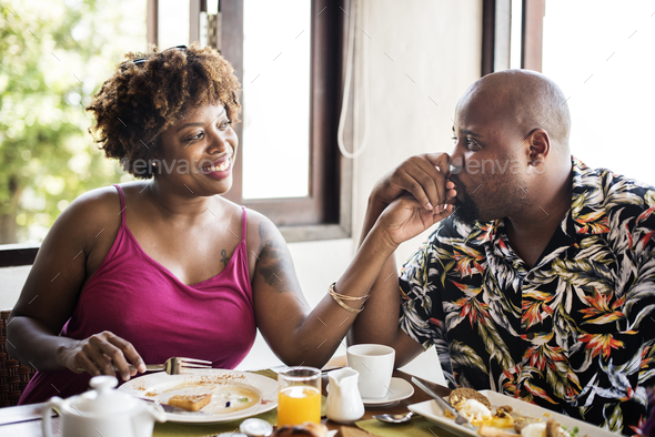 Couple eating a hotel breakfast - Stock Photo - Images