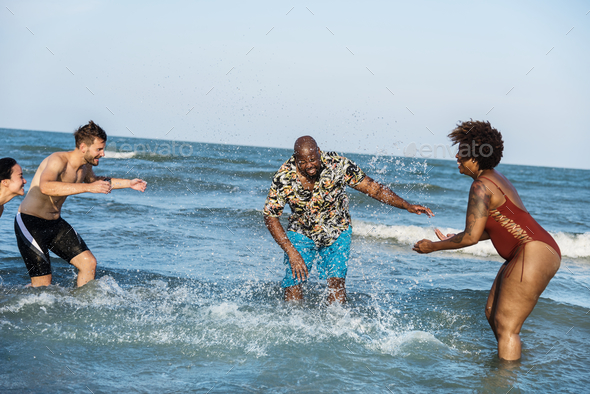 Group of cheerful friends at the beach - Stock Photo - Images