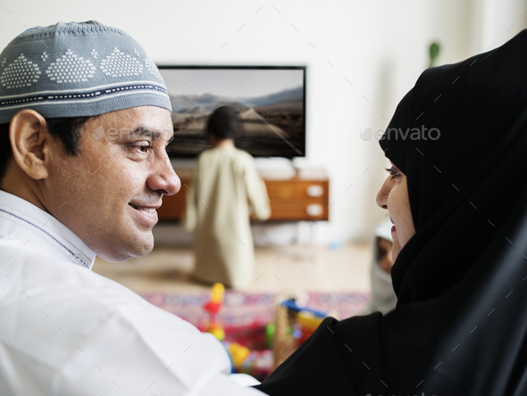 Muslim family relaxing in the home - Stock Photo - Images