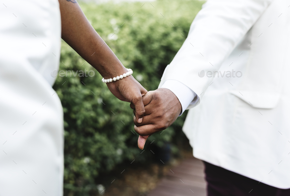 African American couple getting married at an island - Stock Photo - Images