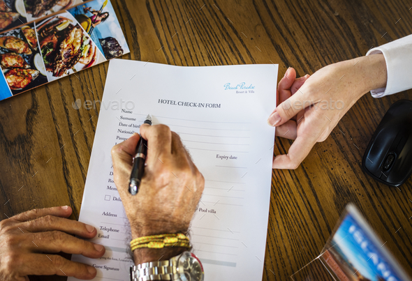 Guest filling hotel check-in form - Stock Photo - Images
