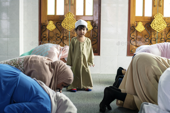 Muslim people praying in Sujud posture - Stock Photo - Images