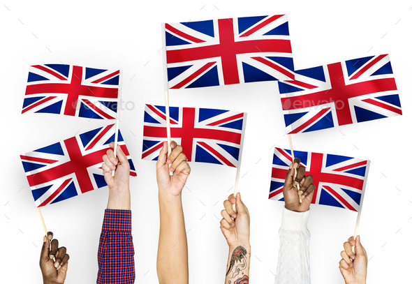 Hands waving the Union Jack - Stock Photo - Images