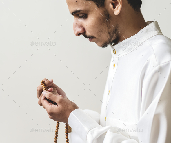 Muslim man with prayer beads - Stock Photo - Images