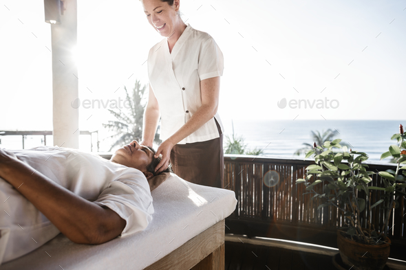 Massage therapist massaging at a spa - Stock Photo - Images