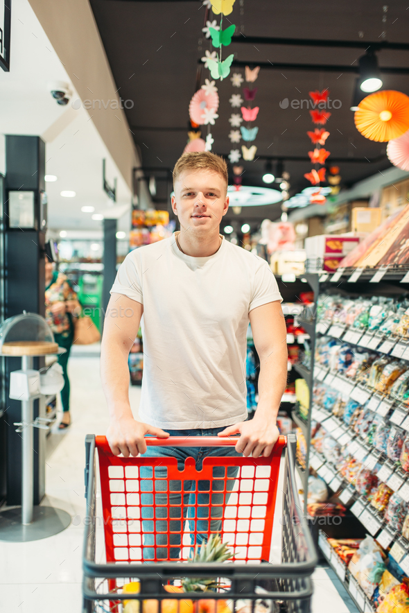 Male customer with cart in food store - Stock Photo - Images
