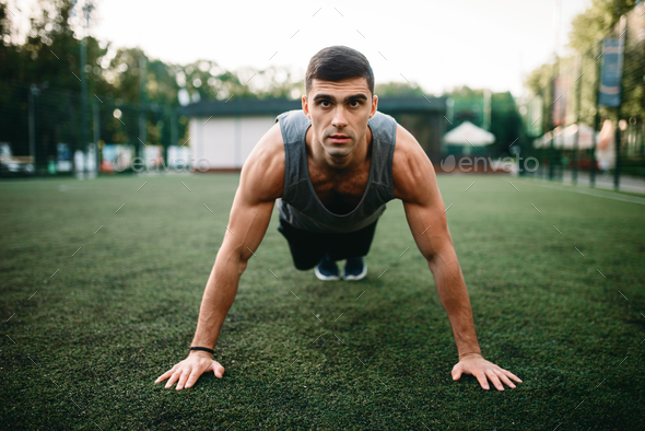 Athlete doing push-up exercise on outdoor workout - Stock Photo - Images