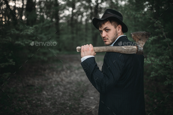 Serial murderer with an axe, bloody maniac - Stock Photo - Images
