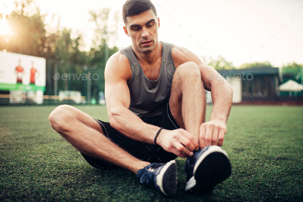 Man prepares for outdoor fitness workout - Stock Photo - Images