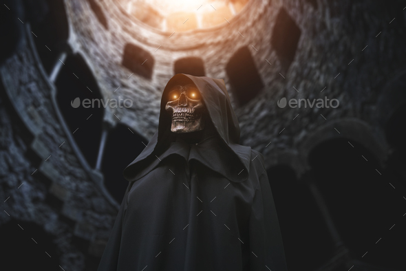Death with burning eyes in abandoned castle - Stock Photo - Images