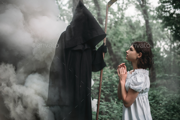 Female victim and death in black hoodie in forest - Stock Photo - Images