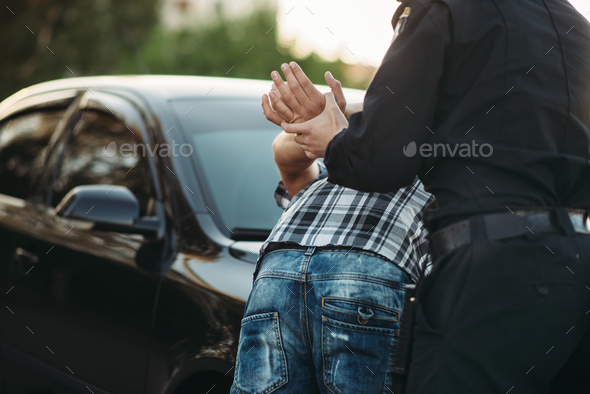 Police officer arrests the driver violator on road - Stock Photo - Images