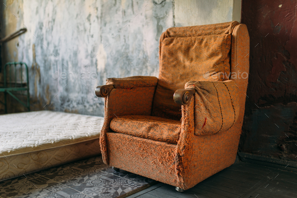 Drug addict room, grunge armchair and mattress - Stock Photo - Images