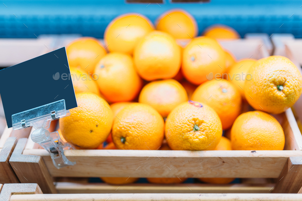 Box with oranges on stand in food store, nobody - Stock Photo - Images