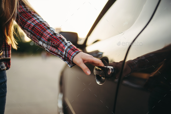 Female hand open car door, driver beginner concept - Stock Photo - Images