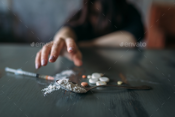 Female junkie hand hand reaching for the dose - Stock Photo - Images