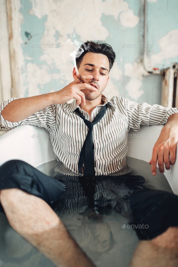 Drunk businessman bankrupt in bathtub, suicide man - Stock Photo - Images