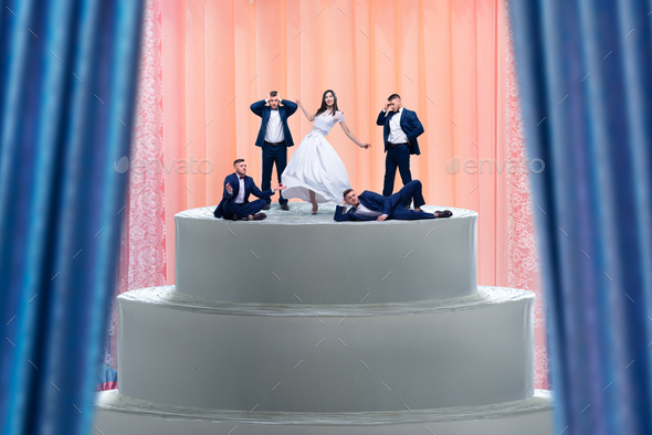 Wedding cake, bride and many grooms figurines - Stock Photo - Images