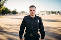 Male police officer in uniform on the road - PhotoDune Item for Sale