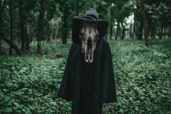 Death in a black hoodie with a scythe in forest - Stock Photo - Images