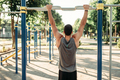 Man doing exercise on horizontal bar outdoor - PhotoDune Item for Sale