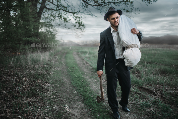 Murderer with an axe, serial maniac concept - Stock Photo - Images