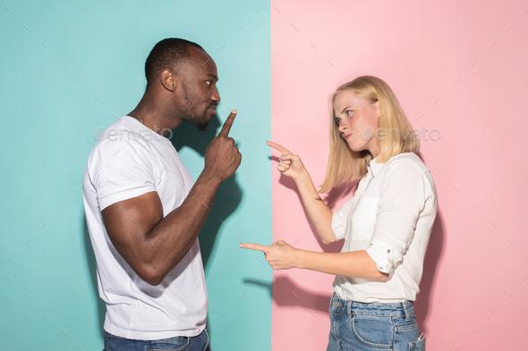 Man and woman posing at studio during quarrel - Stock Photo - Images
