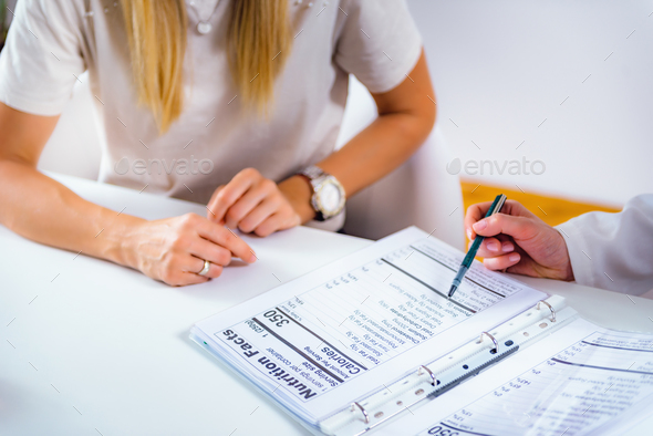 Nutritionist with female patient - Stock Photo - Images