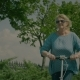 Elderly Woman Enjoying Her Scooter Ride in Nature - VideoHive Item for Sale