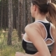 of Woman in Sports Clothes Running Through Woods - VideoHive Item for Sale
