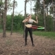 Woman Athlete Engaged with Gymnastic Hoop in Woods in - VideoHive Item for Sale