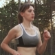Sweaty Athletic Woman Running Through Woods in Athletic Clothes - VideoHive Item for Sale