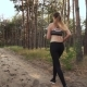 Young Woman Running Through Woods in Athletic Shoes - VideoHive Item for Sale