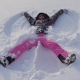 Happy Smiling Caucasian Woman Making Snow Angels In Winter Day - VideoHive Item for Sale