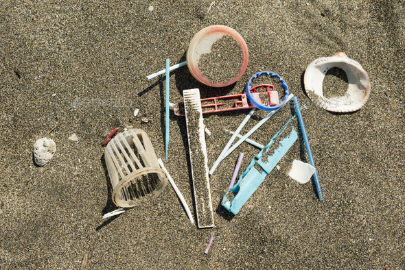 Plastic material on sand beach - Stock Photo - Images