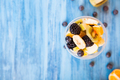 Top view of a cup full of delicious fruits over a wooden desk - PhotoDune Item for Sale