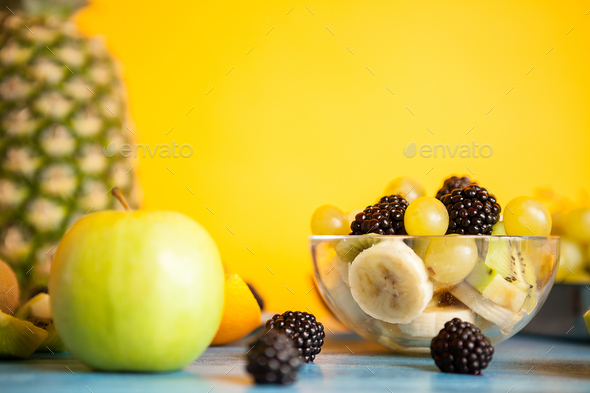 Sliced banana, grapes, kiwi and berry in a bowl - Stock Photo - Images