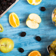 A wooden table with fresh tropical fruits - PhotoDune Item for Sale