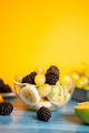 Diet fresh tasty mix of fruits in a bowl on a wooden table - PhotoDune Item for Sale