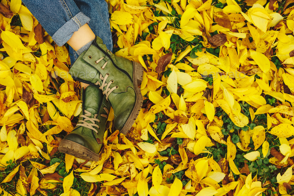 Shoes in yellow autumn leaves - Stock Photo - Images