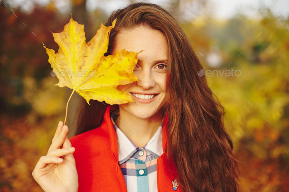 Beautiful young woman with long wavy hair covering face with a l - Stock Photo - Images