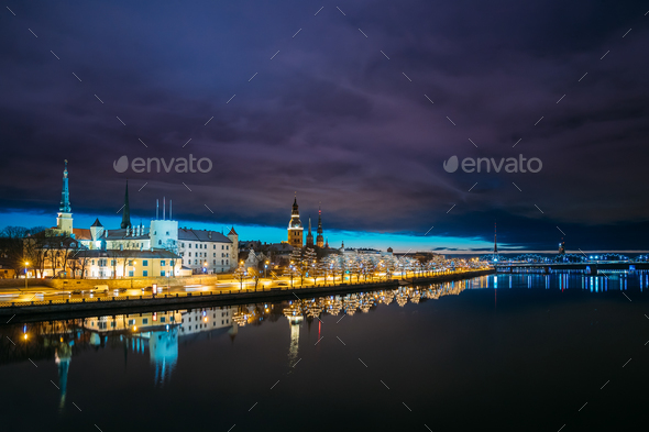 Riga, Latvia. Cityscape In Evening Dusk Time. Night View Of Cast - Stock Photo - Images